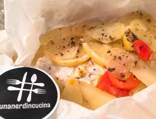 Orata al cartoccio con limone, pomodorini e patate